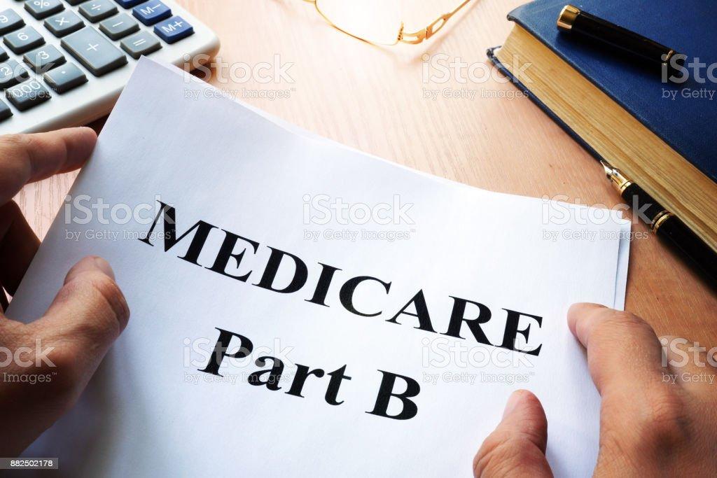 Medicare Part B on a desk. stock photo