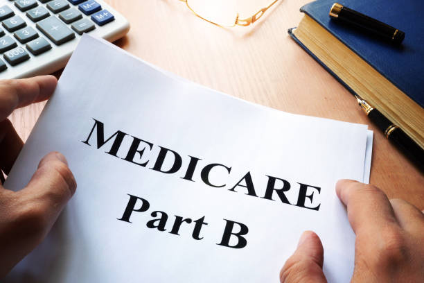 Medicare Part B on a desk. stock photo