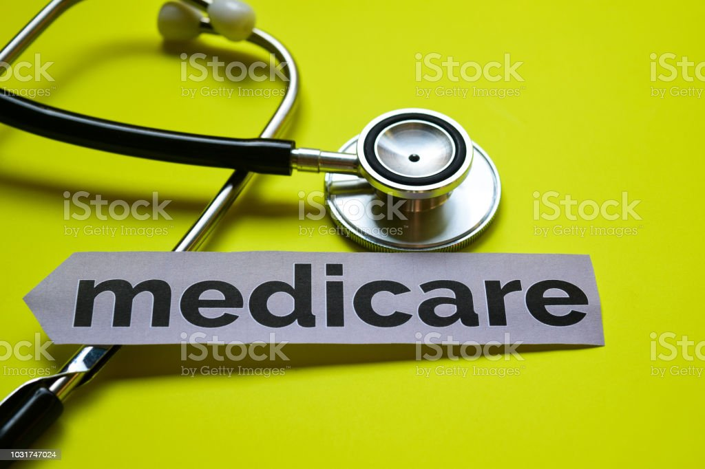 Closeup medicare with stethoscope concept inspiration on yellow...