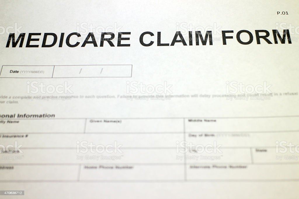 Someone filling out Medicare Claim Form.