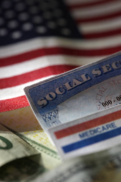 medicare - social security check stock photos and pictures