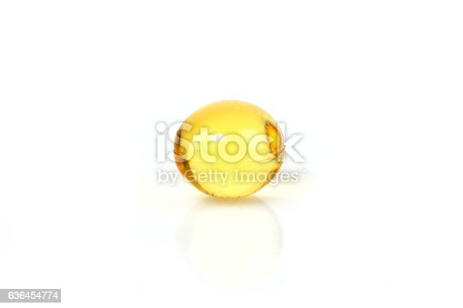 Yellow vitamin capsule on a white background