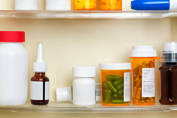 Medications on the Shelves of a Medicine Cabinet stock photo