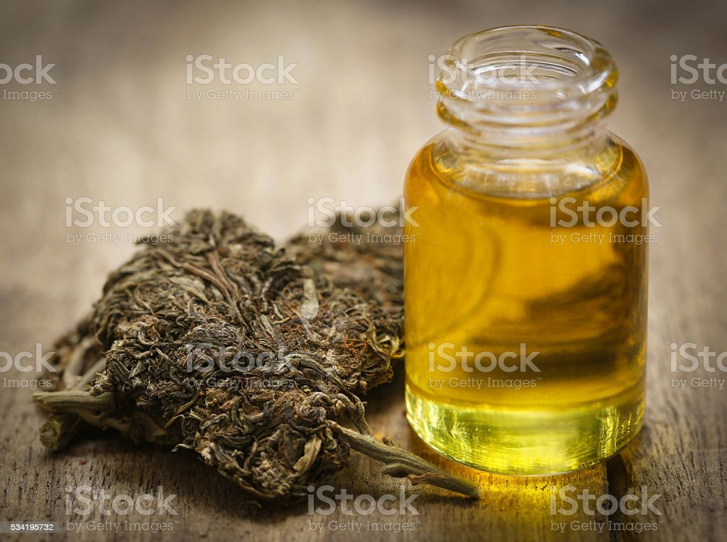 Medicinal cannabis with extract oil stock photo