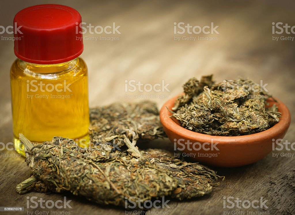 Medicinal cannabis with extracted oil stock photo