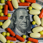 istock Medicinal different pills on the background of banknotes 1216632609