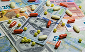 istock Medicinal different pills on the background of banknotes 1216632613