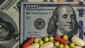istock Medicinal different pills on the background of banknotes 1216632616