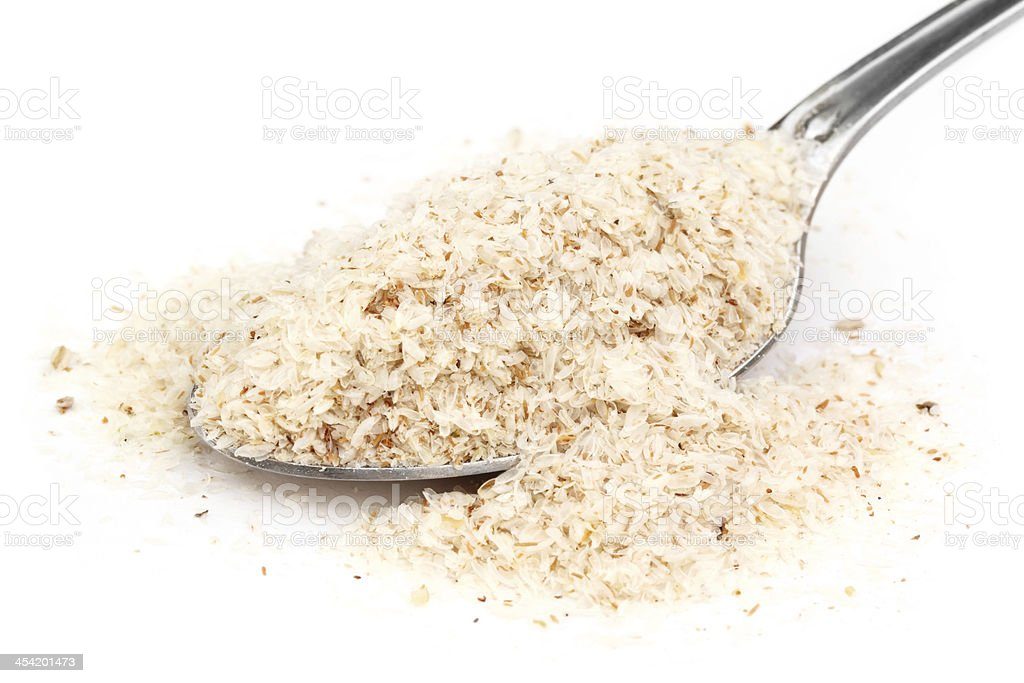 Medicinal Isabgol or psyllium husks with spoon stock photo
