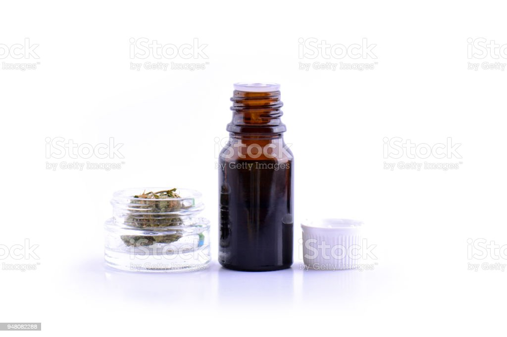 Medicinal marijuana cannabis with extract oil in a bottle. cannabis CBD oil hemp products. Cannabis oil extracts in jar stock photo