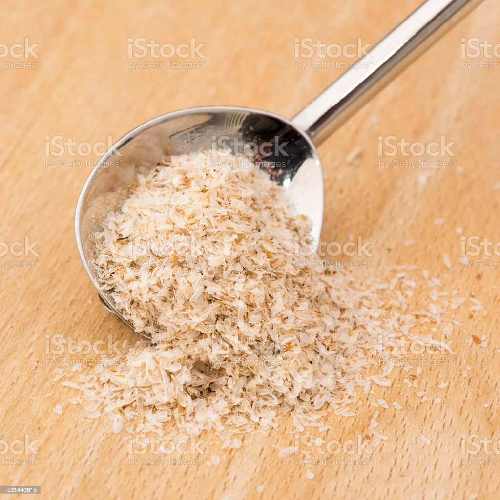 Medicinal psyllium husks with a spoon stock photo