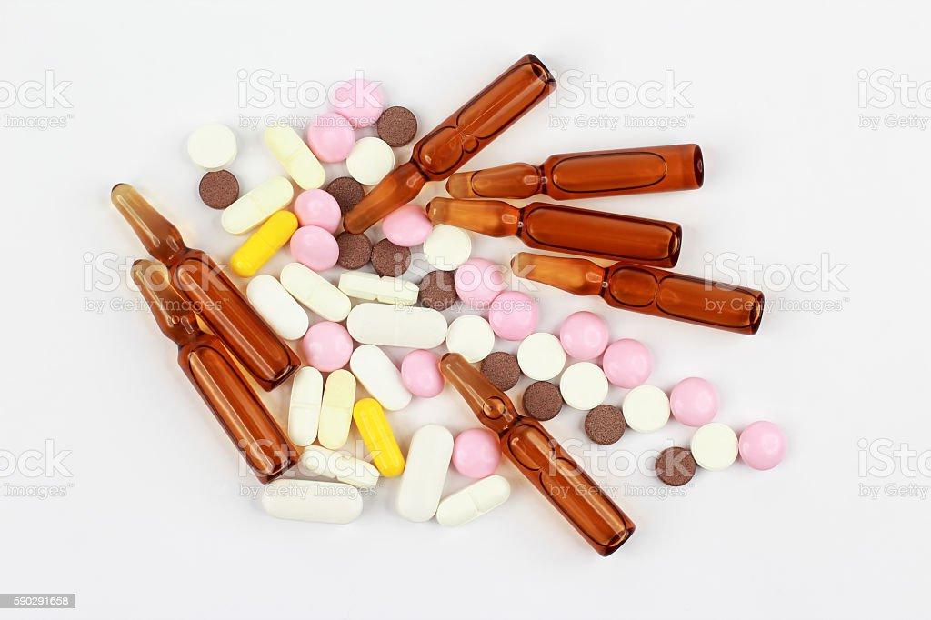 medicinal tablets, ampules for injections on white background royaltyfri bildbanksbilder