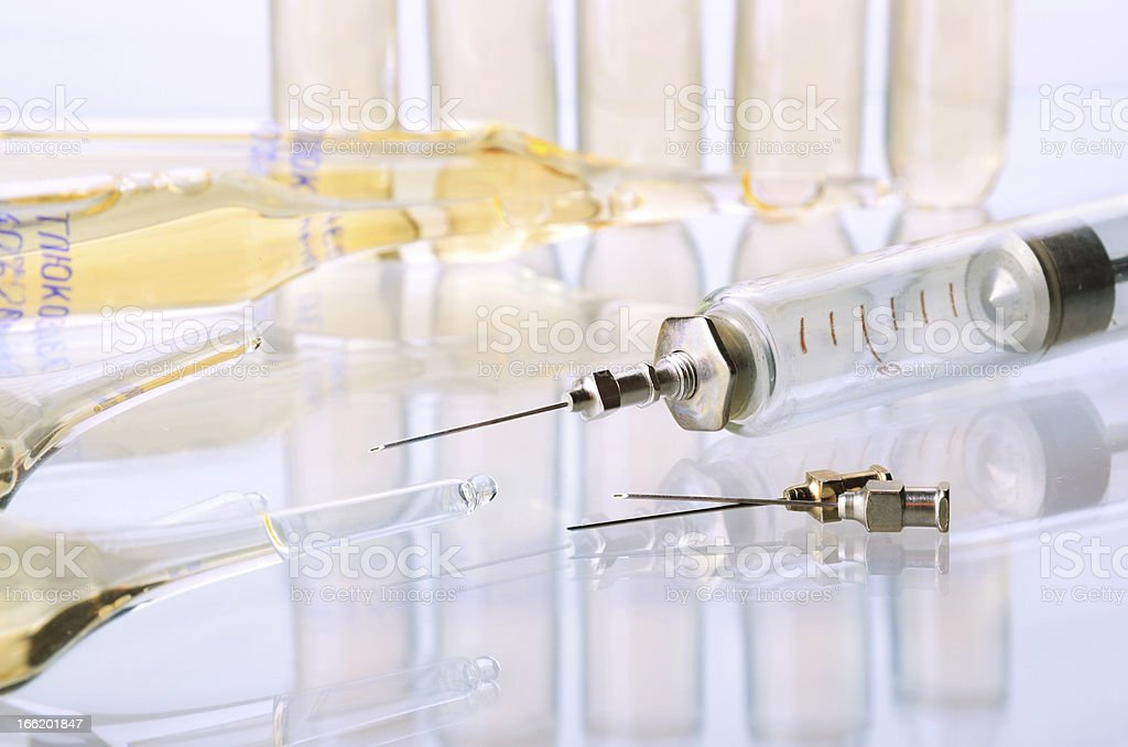 Medicine ampulas and syringe royalty-free stock photo