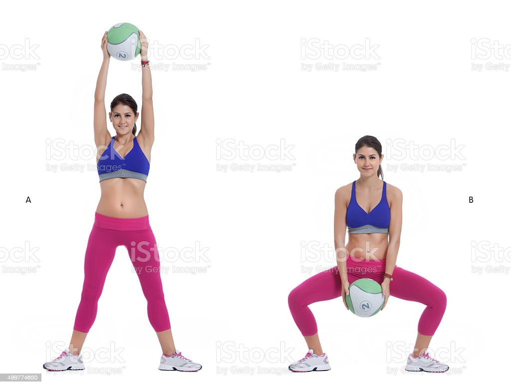 Medicine Ball Squat with Overhead Lift stock photo
