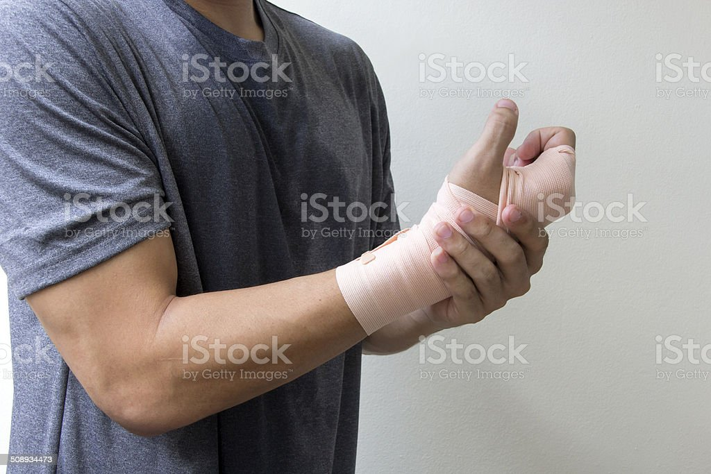 medicine bandage on injury hand stock photo