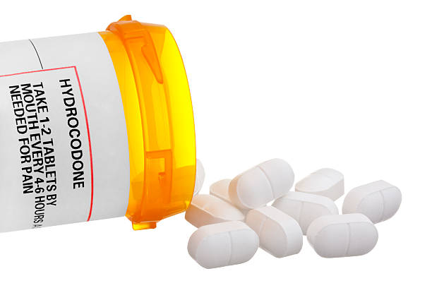 Medicine Bottle with Hydrocodone Label and Tablets stock photo