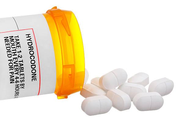 Medizin-Flasche mit Hydrocodone Label und Tablets – Foto