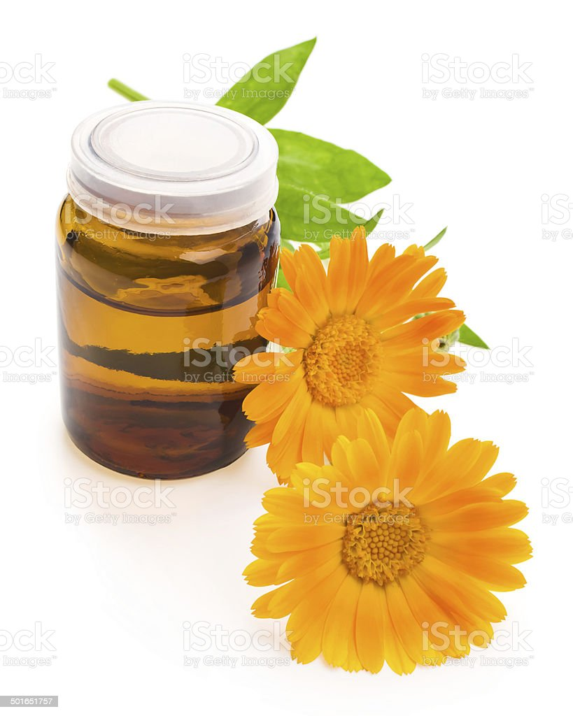 medicine bottles and calendula flower, isolated on white stock photo