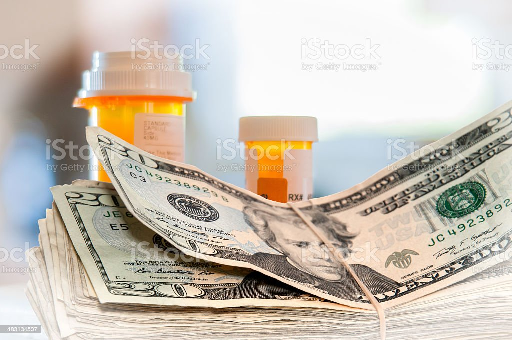 Medicine Bottles and Money stock photo