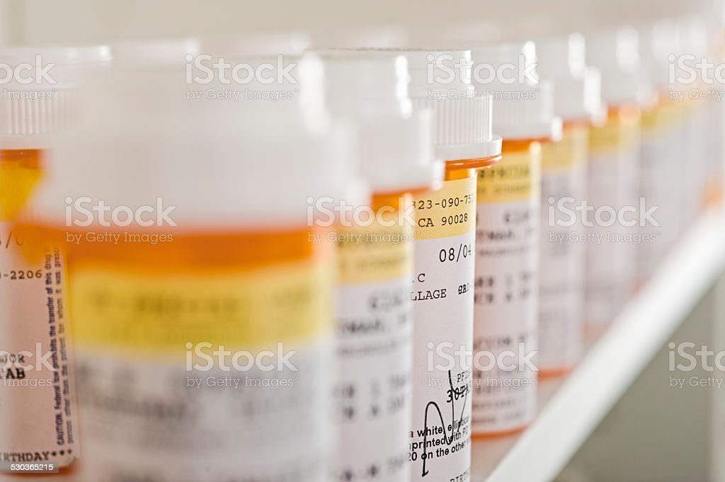 Medicine Bottles Arranged In Shelf stock photo