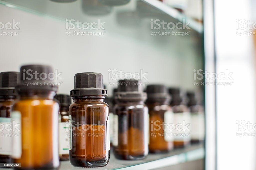 Medicine bottles arranged in shelf stock photo