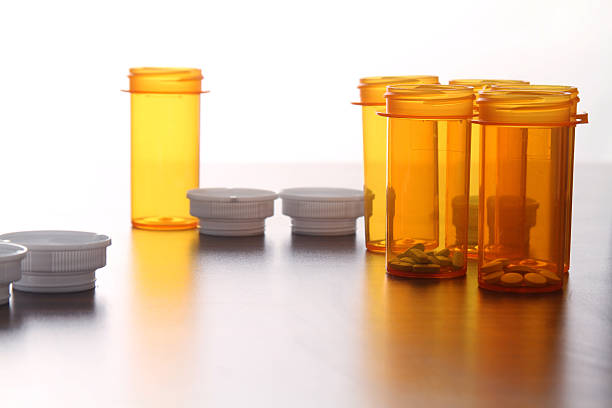 medicine bottles with pills stock photo