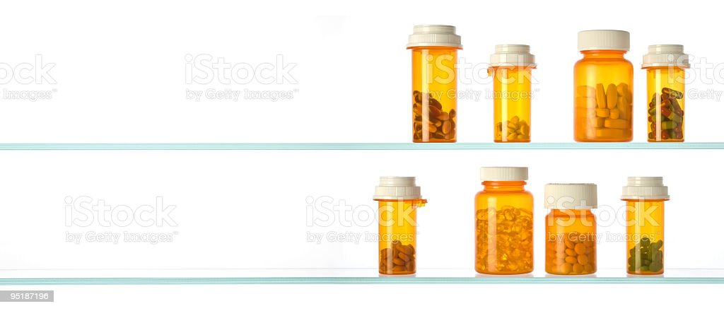 medicine cabinet with pill bottles and empty shelf royalty-free stock photo