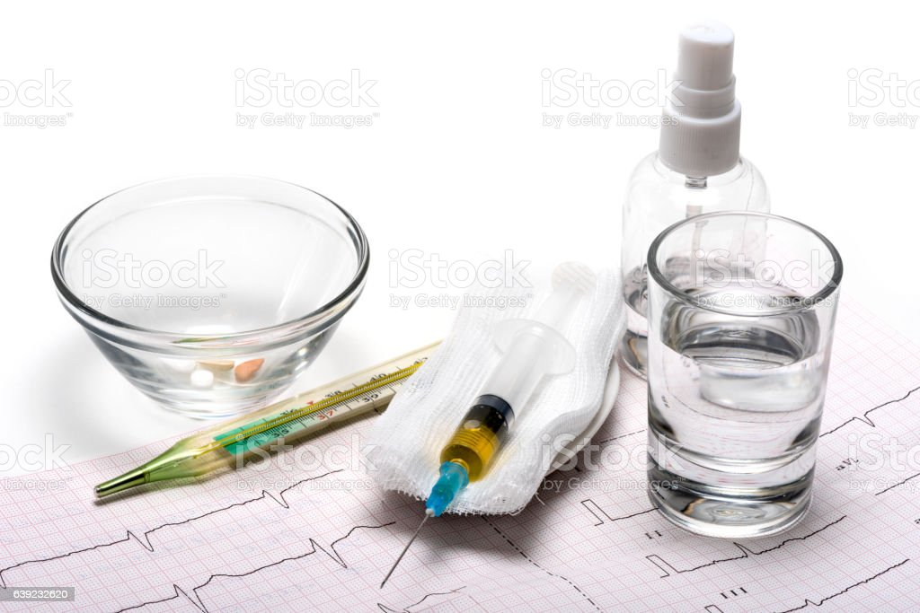 medicine, cardiograms and pills to fight disease stock photo