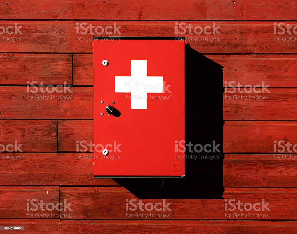 Medicine chest on an old wooden fence in sunlight stock photo