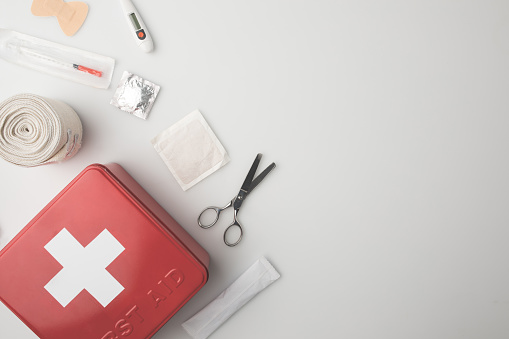 Top view of medicine chest with medical supplies isolated on white