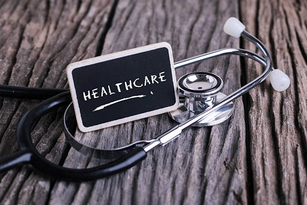 Medicine concept. Blackboard with word healthcare and stethoscop – Foto