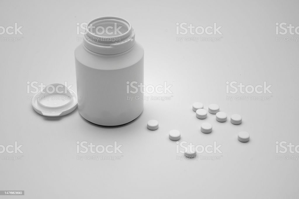 Medicine container with pills royalty-free stock photo