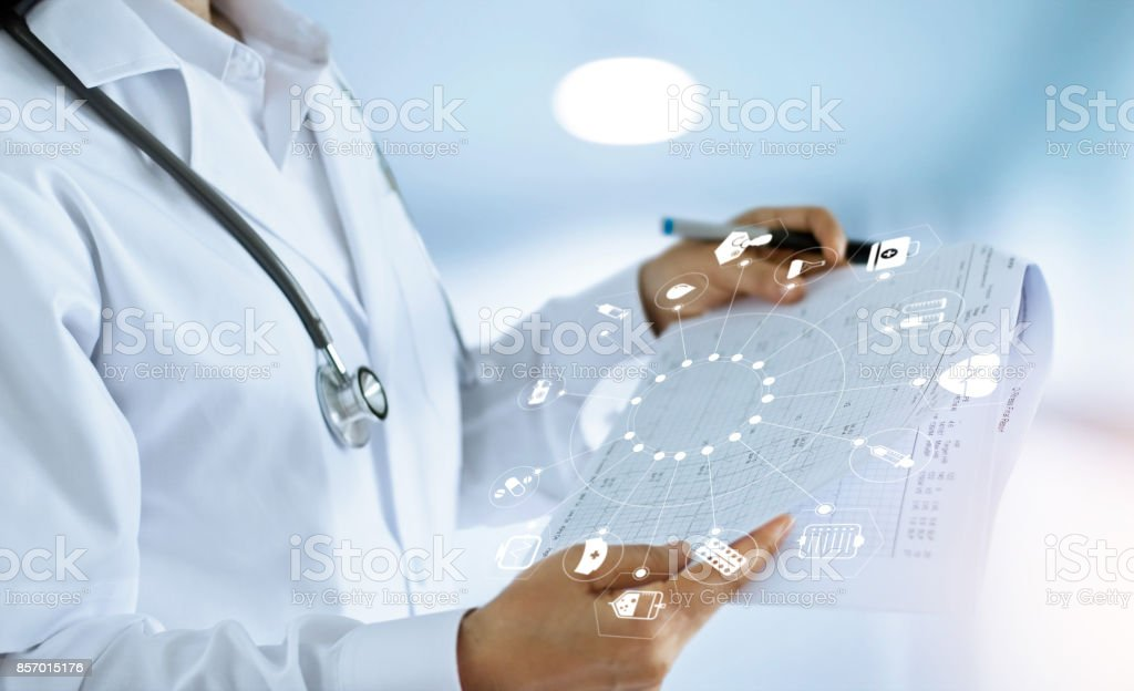 Medicine doctor and medical Report in hand with icon medical network connection in hospital background, medical technology network concept stock photo