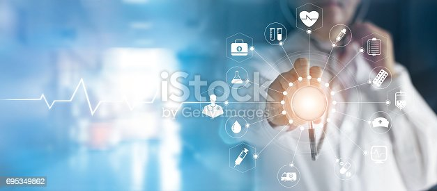 istock Medicine doctor and stethoscope in hand touching icon medical network connection with modern virtual screen interface, medical technology network concept 695349862