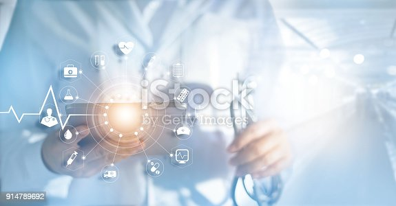 istock Medicine doctor and stethoscope in hand with icon medical network connection with modern virtual screen interfacein hospital background, medical technology network concept 914789692