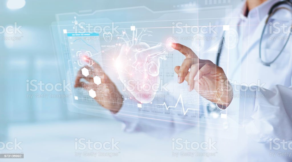 Medicine doctor and stethoscope touching icon heart and diagnostics analysis medical on modern virtual screen interface network connection. Medical technology diagnostics of heart concept stock photo
