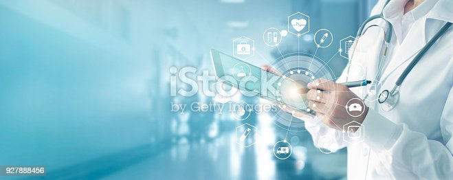 927897070istockphoto Medicine doctor and stethoscope touching icon medical network connection with modern interface on digital tablet in hospital background. Medical technology network concept 927888456