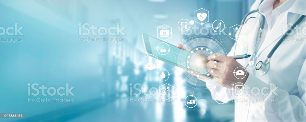 Medicine doctor and stethoscope touching icon medical network connection with modern interface on digital tablet in hospital background. Medical technology network concept stock photo