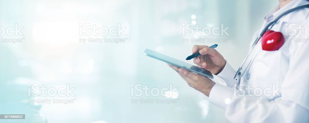 Medicine doctor and stethoscope touching medical information network connection interface on digital tablet in hospital background. Medical data and technology network concept stock photo