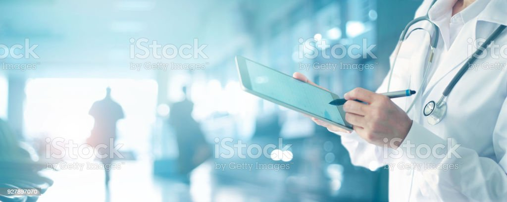 Medicine doctor and stethoscope touching medical information network connection interface on digital tablet in hospital background. Medical data and technology network concept - foto stock
