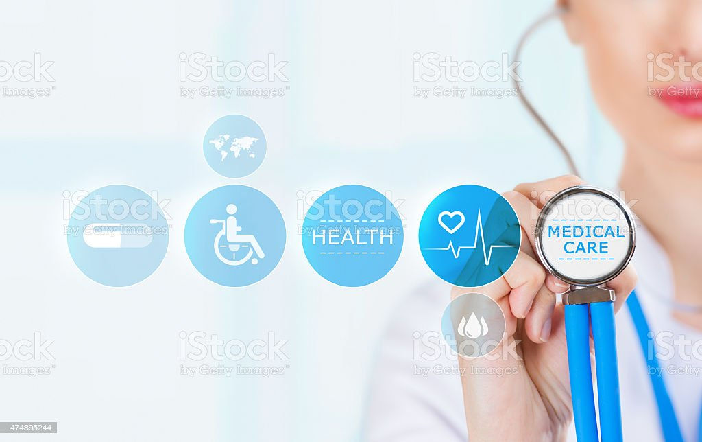 Medicine doctor hand holding stethoscope and working with medical icons stock photo