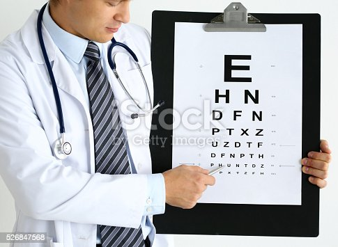 istock Medicine doctor hold big clipboard pad with eyesight check table 526847568