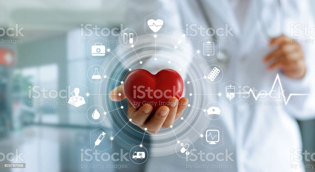 Medicine doctor holding red heart shape in hand and icon medical network connection with modern virtual screen interface, medical technology network concept stock photo
