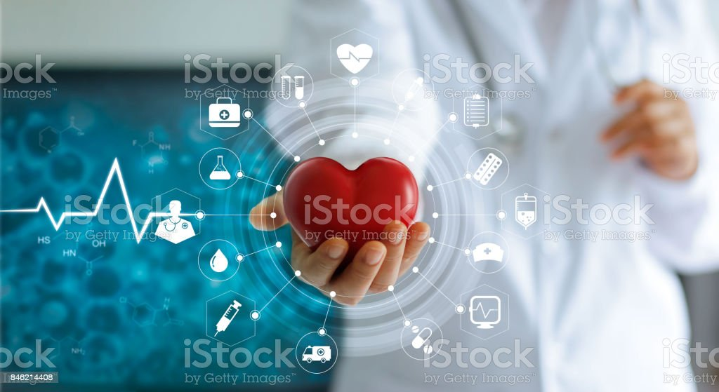Medicine doctor holding red heart shape in hand and icon medical network connection with modern virtual screen interface in laboratory, medical technology network concept stock photo