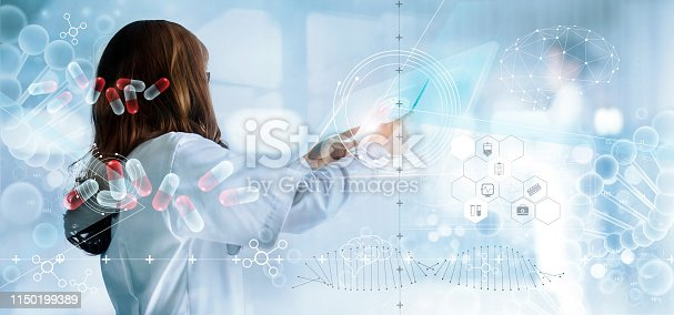 927897070istockphoto Medicine doctor holding virtual interface and medical analysis on hologram modern screen, report record. DNA. Digital healthcare and network connection, innovative, medical technology and network concept 1150199389
