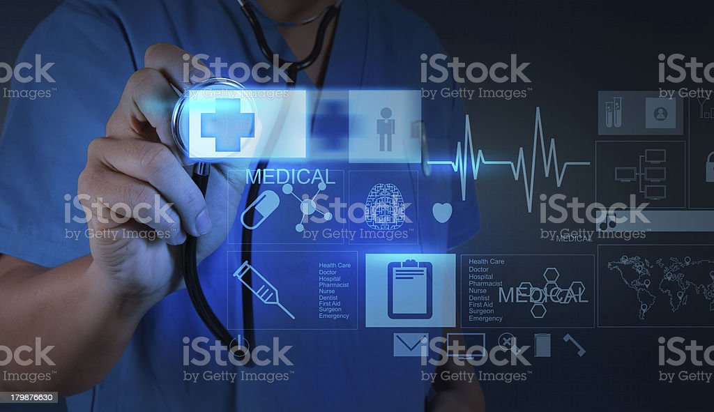 Medicine doctor pushing on first aid sign with modern computer stock photo