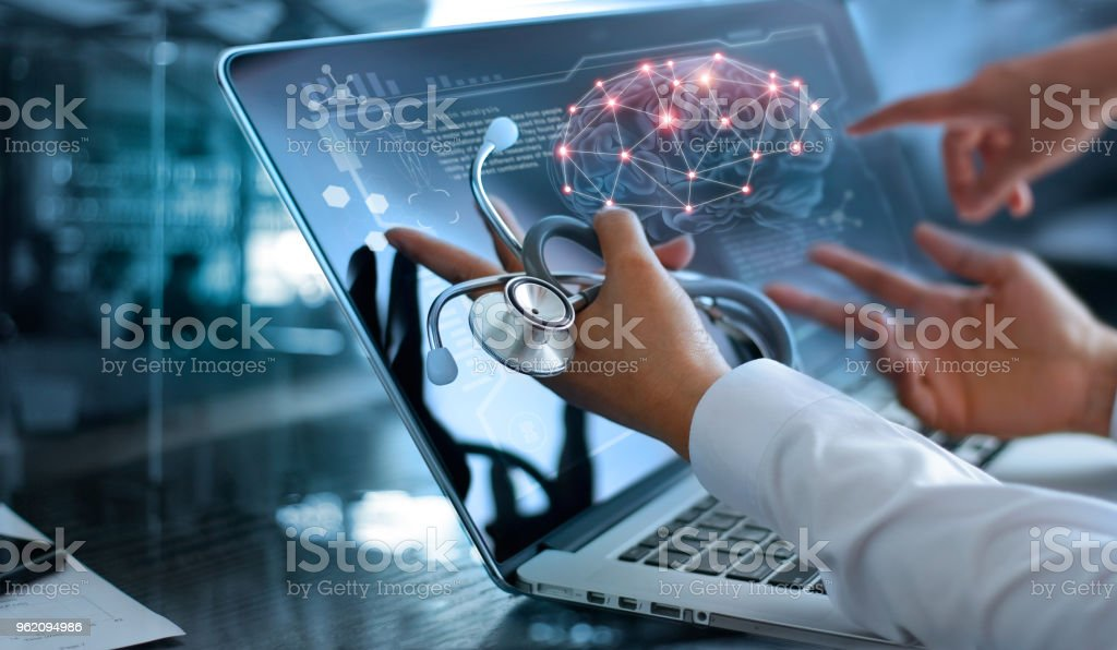 Medicine doctor team meeting and analysis. Diagnose checking brain testing result with modern virtual screen interface on laptop with stethoscope in hand, Medical technology network connection concept. stock photo