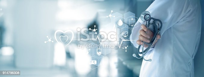 istock Medicine doctor with stethoscope in hand and icon medical network connection on  virtual screen interface. Modern medical technology and innovation concept 914796308