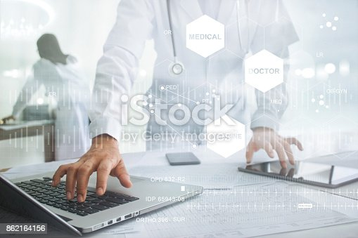 845455852 istock photo Medicine doctor with stethoscope touching icon medical network connection on laptop and tablet with modern virtual screen interface, medical technology network concept 862164156