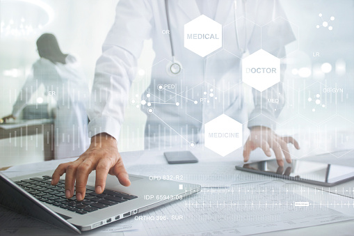927897070 istock photo Medicine doctor with stethoscope touching icon medical network connection on laptop and tablet with modern virtual screen interface, medical technology network concept 862164156